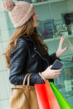 Young woman goes shopping in the city Royalty Free Stock Photography