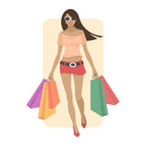 Young woman goes shopping Royalty Free Stock Photos