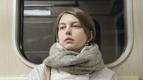 Young woman goes by train and listen music.  stock video footage