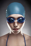 Young woman in goggles and swimming cap Royalty Free Stock Image