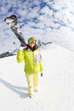 Young woman going mountain ski on winter resort Stock Photography