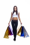 Young woman is going with paper bags Royalty Free Stock Photo
