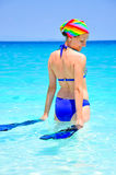 Young woman going for a swim. In the ocean Stock Images