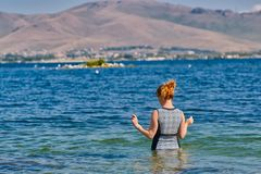 Young Woman going swimming in Lake Sevan of Armenia stock photo