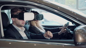 Young woman going for a test drive in a new car using VR stock video footage