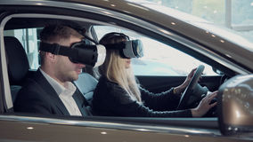 Young woman going for a test drive in a new car using VR stock photos