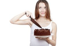 Young woman is going to cut a piece of cake Royalty Free Stock Photo