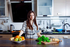 Young woman is going to prepare a salad Stock Photo