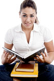 Young woman going to read book Stock Images