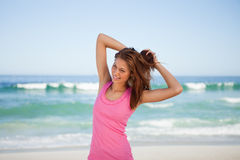 Young woman going to tie up her hair Royalty Free Stock Photos