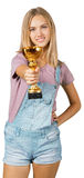 Young woman with golden cup Royalty Free Stock Photography
