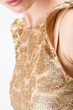 Young woman in golden dress. On white background Royalty Free Stock Photos
