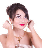 Young woman with golden jewelry Royalty Free Stock Photography