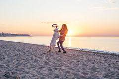 Young woman with  golden retriever on the beach Stock Images