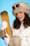 Young woman with golden skis Royalty Free Stock Photography