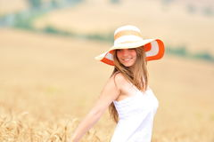 Young woman in golden wheat field Stock Image