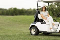 Young woman at golf cart Royalty Free Stock Photos