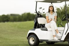 Young woman at golf cart Royalty Free Stock Images