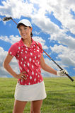 Young Woman on Golf Course Royalty Free Stock Image
