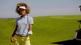 Young woman golfer watching her ball on the course stock video