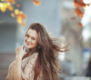 Young woman with gorgeous windy hair Royalty Free Stock Photography