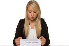 Young woman got a job application rejection a looks astonished. Young good-looking woman with pure 100 percent white background Stock Photo