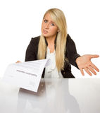Young woman got a job application rejection a looks astonished. Young good-looking woman with pure 100 percent white background Stock Photos