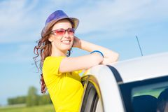 Young woman got out of car window Royalty Free Stock Image