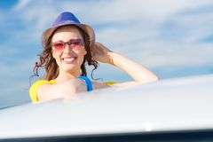 Young woman got out of car window Royalty Free Stock Photography