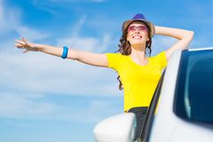 Young woman got out of car window Stock Photography