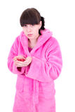 The young woman gown holds a handful of tablets. The young woman in a dressing gown holds a handful of tablets Royalty Free Stock Photography