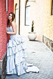 Young Woman in a Gown Leaning Against the Wall stock image