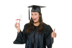 Young Woman Graduate Receives. Very happy and proud beautiful young woman standing in graduation robes, cap and gown holding her diploma or degree with an Royalty Free Stock Photos