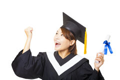 young woman graduating holding diploma and looking Stock Photos