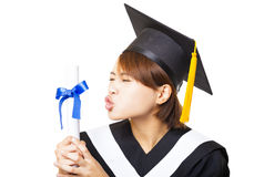 young woman graduating kissing diploma Stock Photo