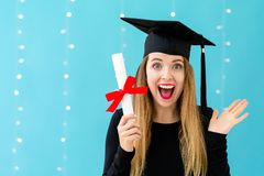 Young woman with a graduation diploma stock images
