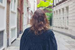 Young woman in graduation gown Stock Images