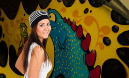 Young woman and graffiti Royalty Free Stock Image
