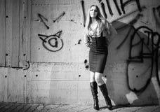Young woman on graffiti wall background Stock Photo