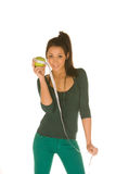 Young woman with granny smith apple Royalty Free Stock Photos