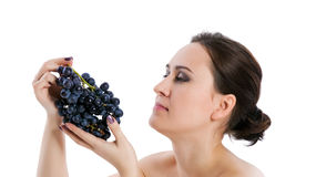 Young woman with grape Royalty Free Stock Image