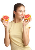 Young woman with grapefruit Royalty Free Stock Photos