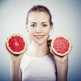 Young woman with grapefruit Stock Image