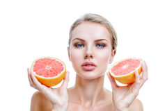 Young woman with grapefruit in hands Stock Photography