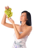 Young woman with grapes Royalty Free Stock Photo