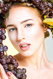 Young woman with grapes. Young woman with natural makeup and grapes Royalty Free Stock Images