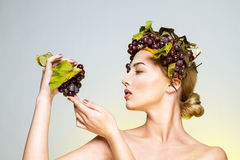 Young woman with grapes Stock Photos