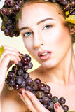Young woman with grapes. Young woman with natural makeup and grapes Stock Photography
