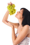 Young woman with grapes portrait royalty free stock photography