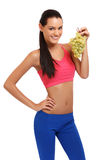 Young woman with grapes on white background Royalty Free Stock Photography